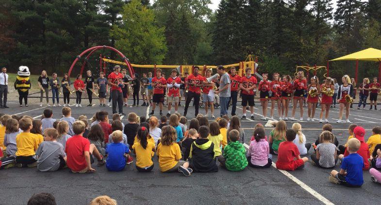 Football players and cheerleaders 2 at pep rally