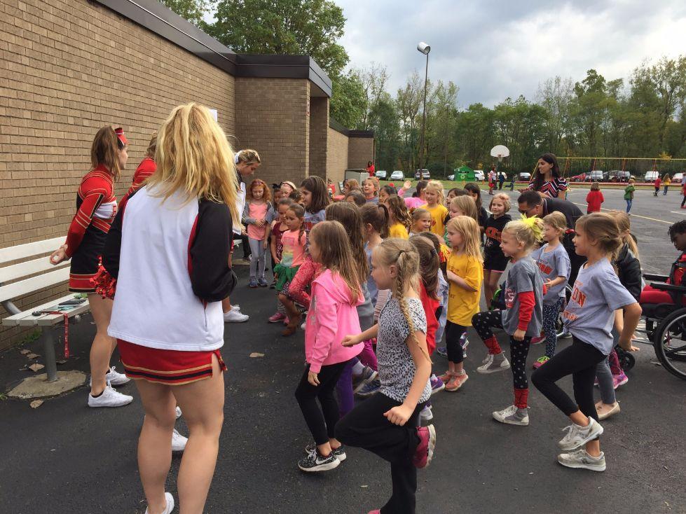 Cheerleaders teaching cheers at pep rally 2
