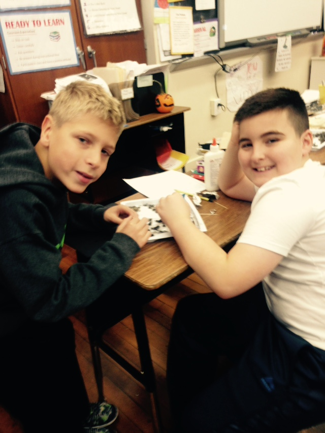 Boys working in science class