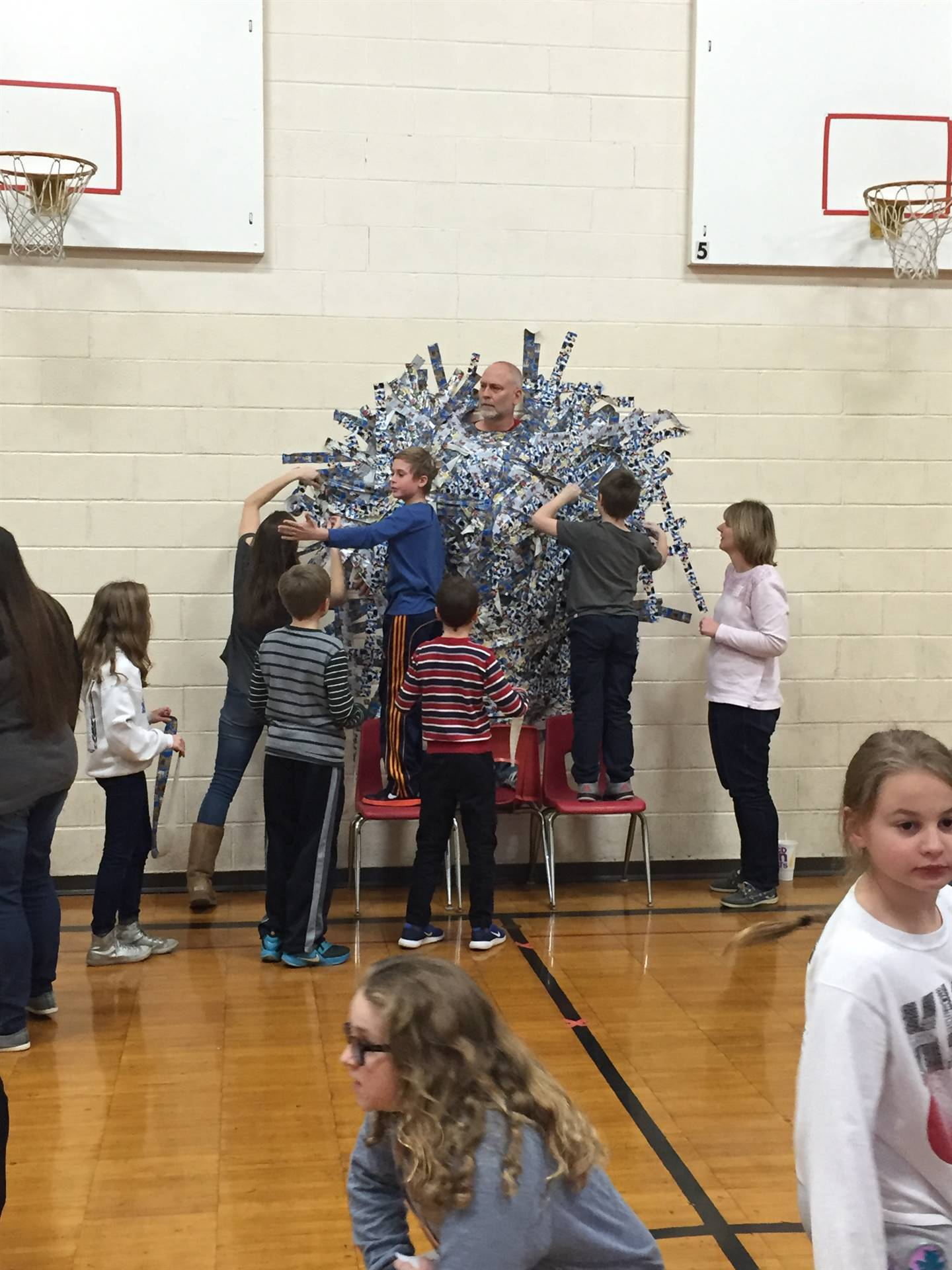 Mr. Hartland being taped to the wall