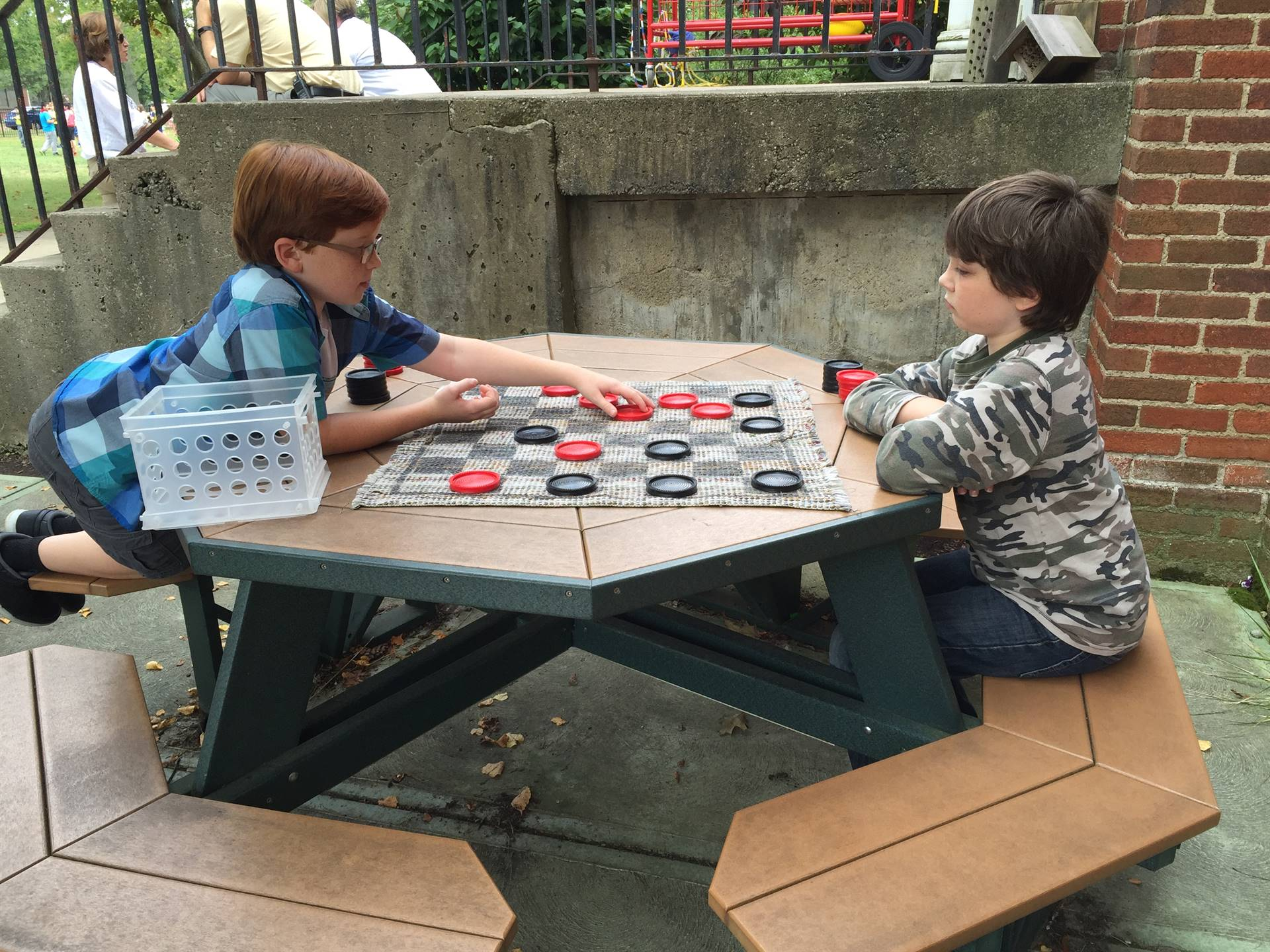 Boys playing checkers at recess