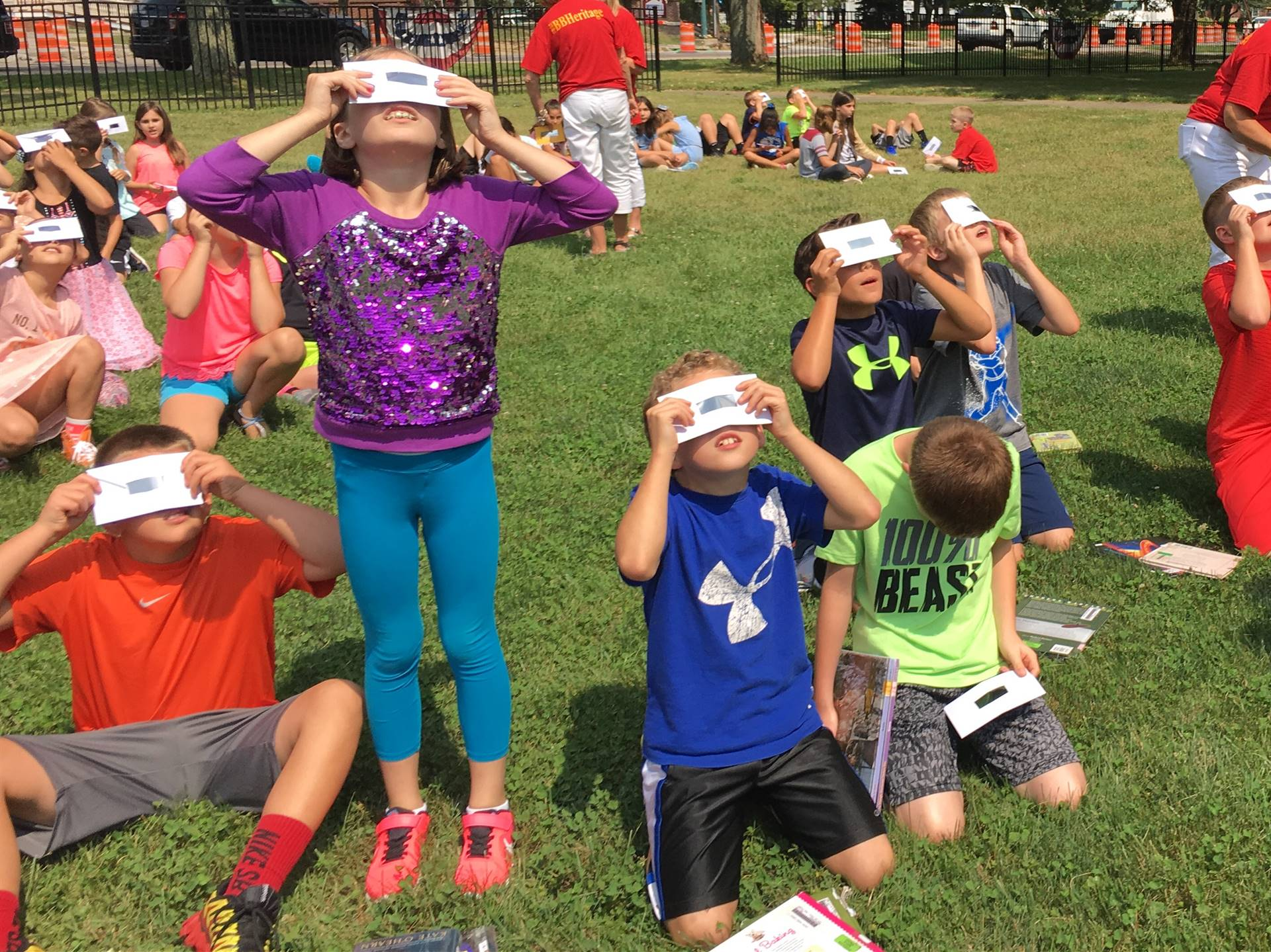 Students looking at the eclipse