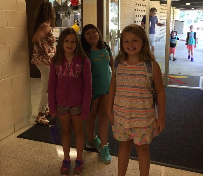 3rd grade girls arriving at school