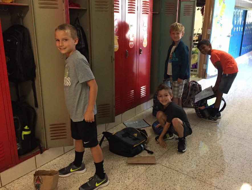 2nd grade students at lockers