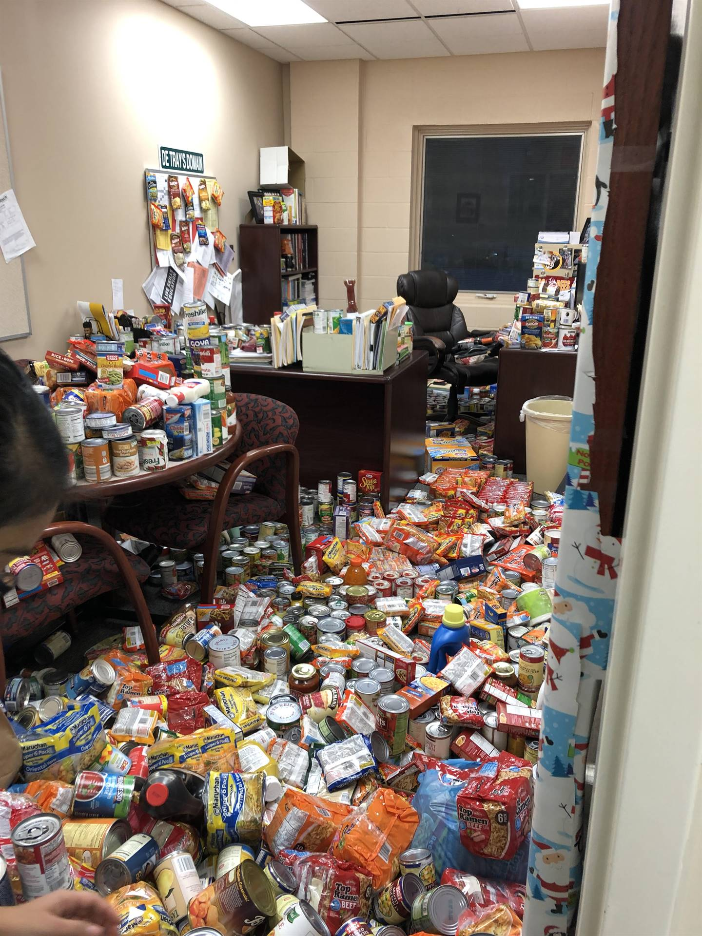Mr. Detrays office with canned goods