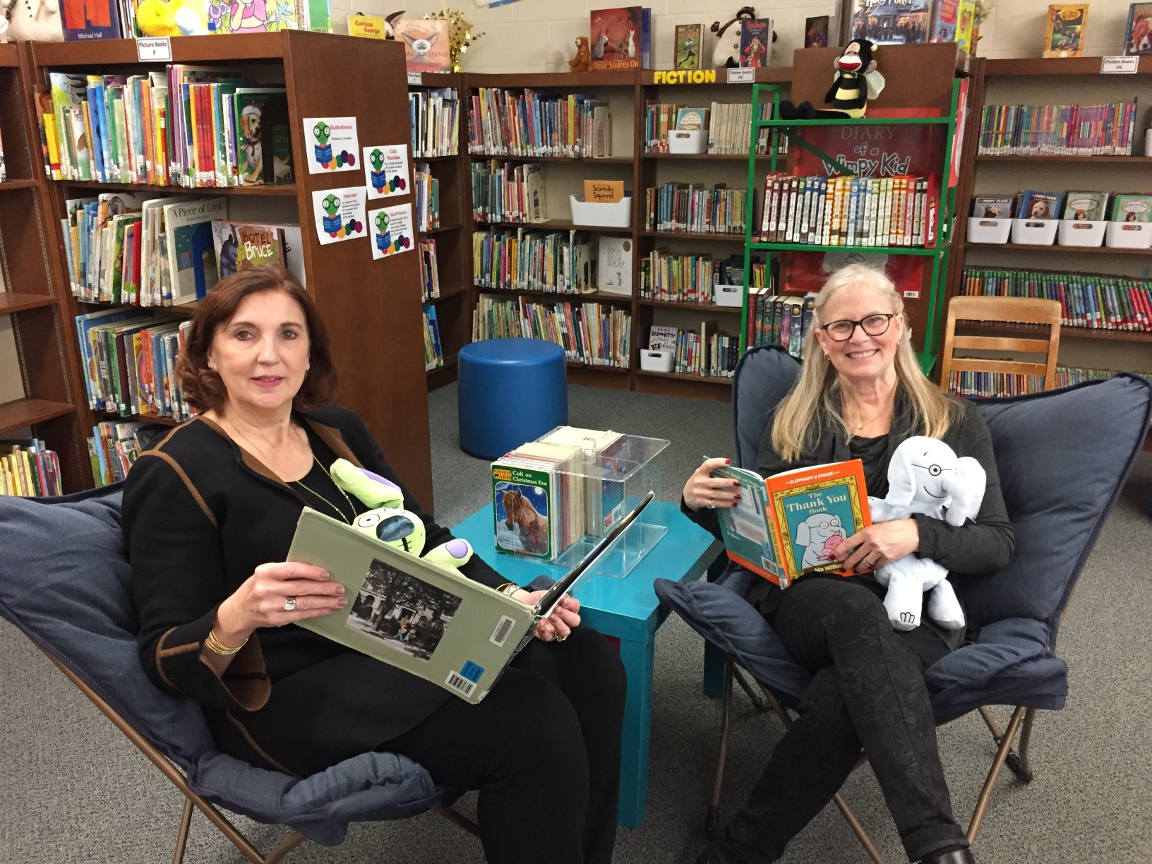Mrs. Pana and Mrs. Blaustein in the library