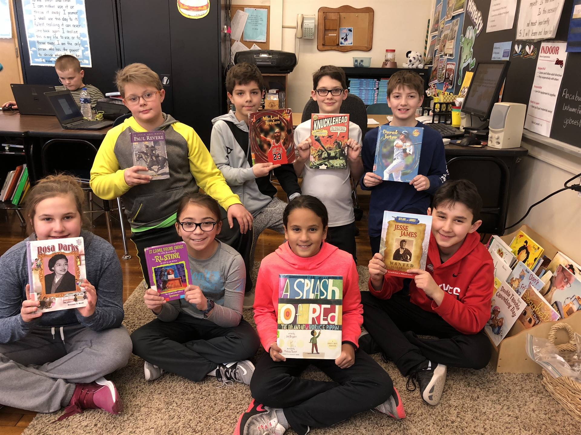 5th graders with new books