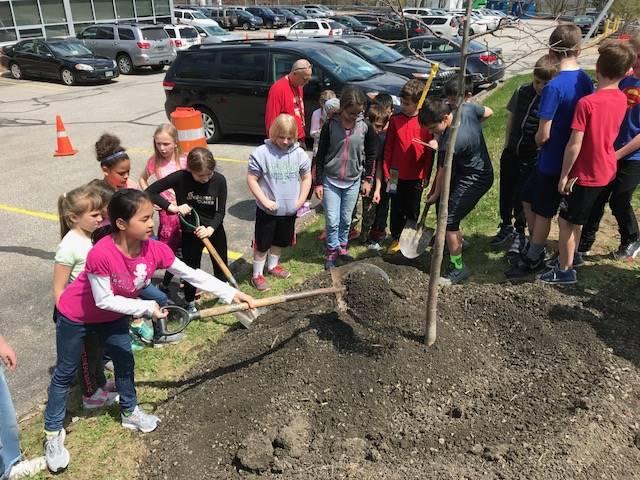 Kids planting Arbor Day tree