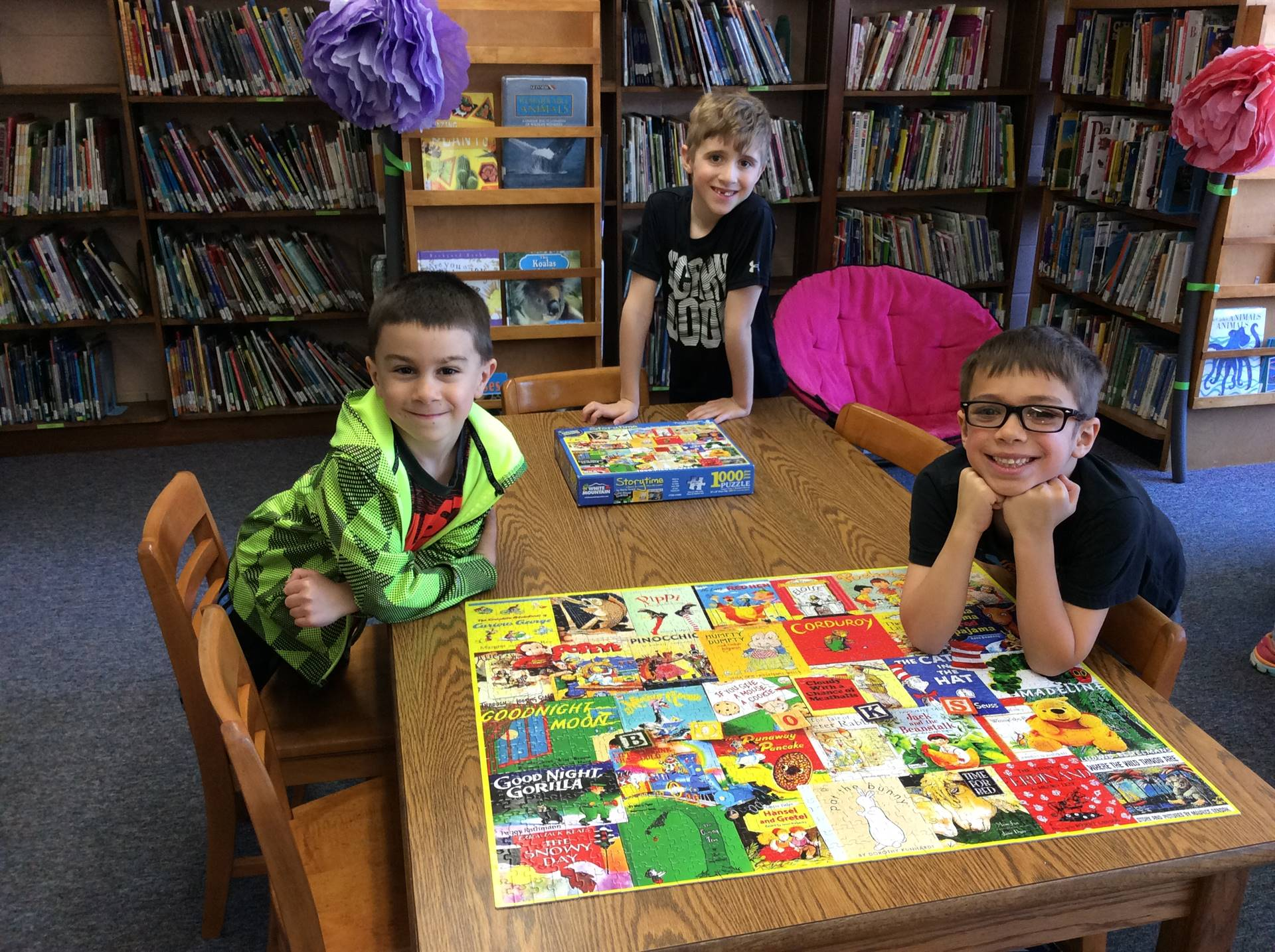 Students complete 1,000 piece puzzle.