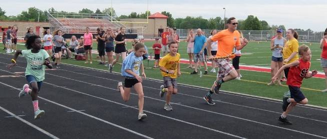 Field Day 18- Mr. Martin racing 3rd graders