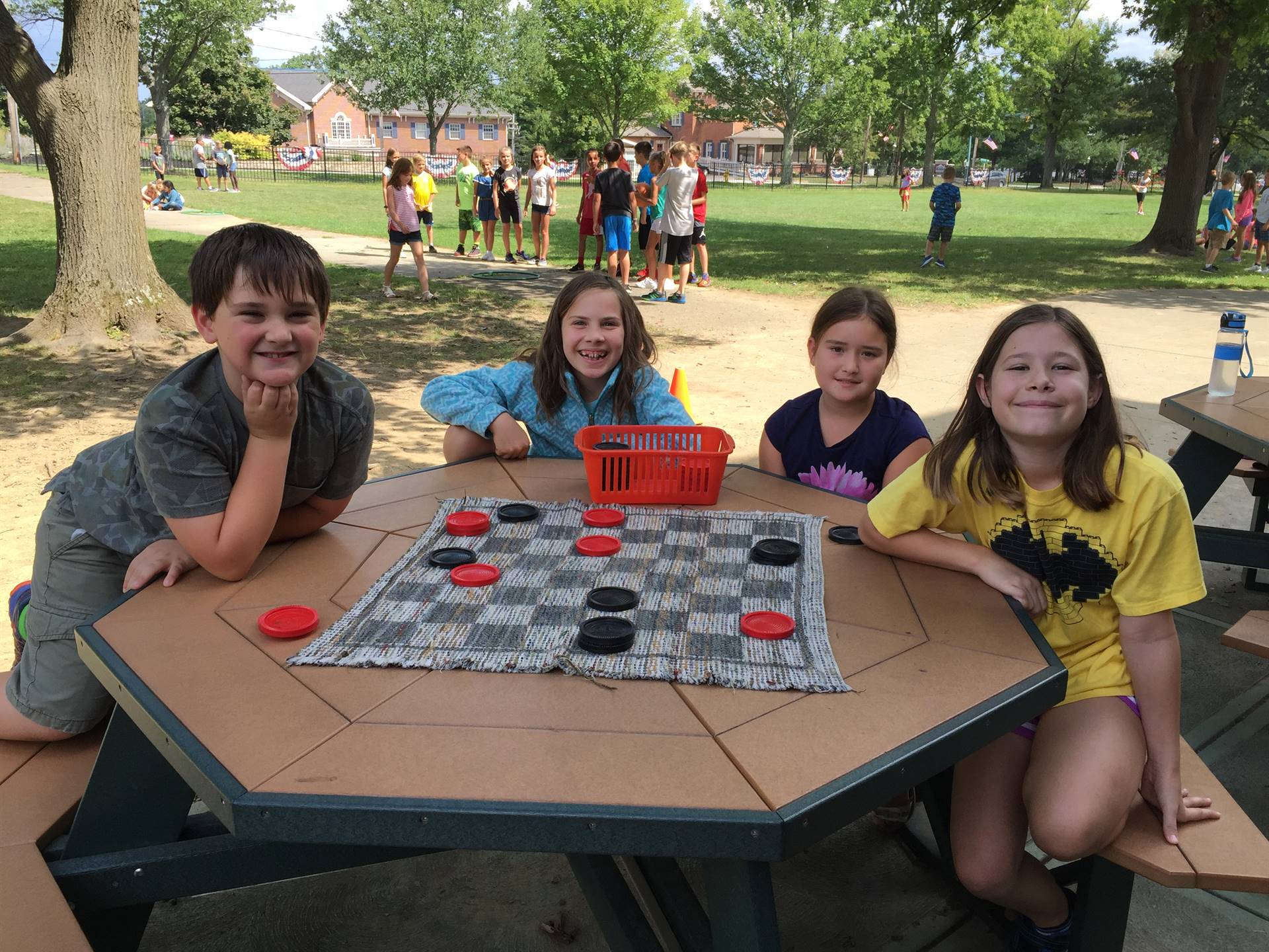 Recess kids playing checkers