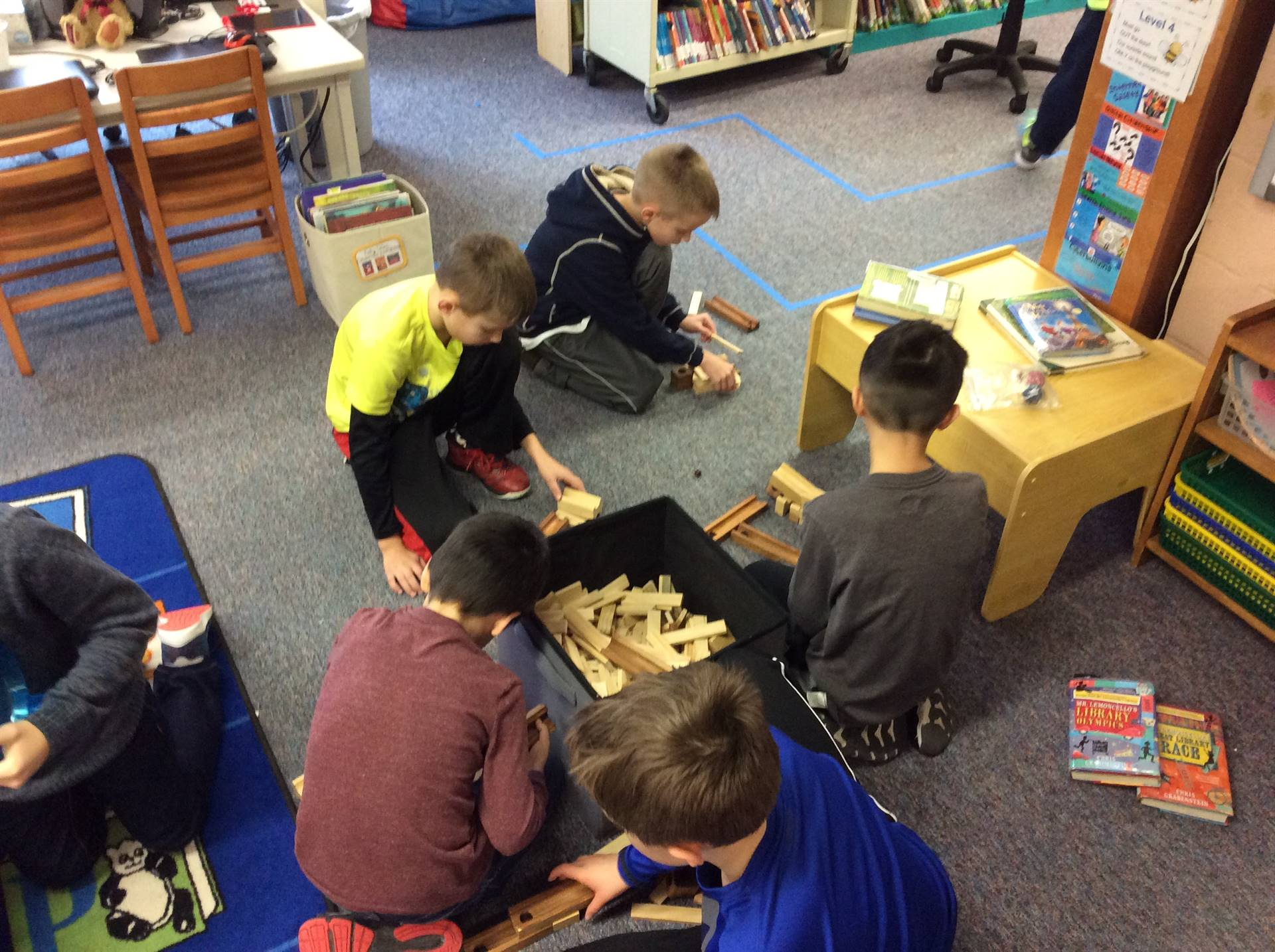 Building with Keva blocks marble tracks